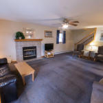 1,800 Sq. ft., 4 bedroom townhouse - Living area with stairs, fireplace, and coffee table