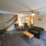 2,000 sq. ft. townhouse with 4 bedrooms - View of the living area with couch and staircase