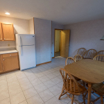 2,000 sq. ft. townhouse with 4 bedrooms - Kitchen area and dining table
