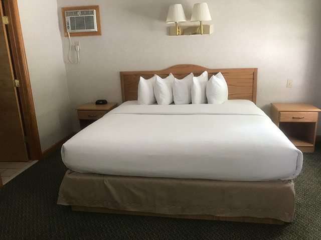 King Whirlpool Room with White Bedding