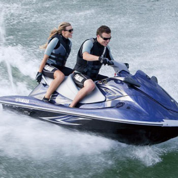 Photo of people riding a jet ski