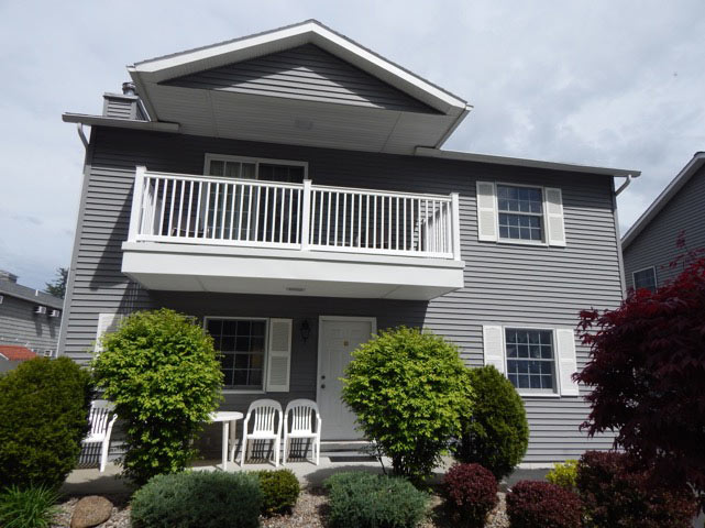 exterior of a townhouse at Americas Best Value Inn & Suites Lake George